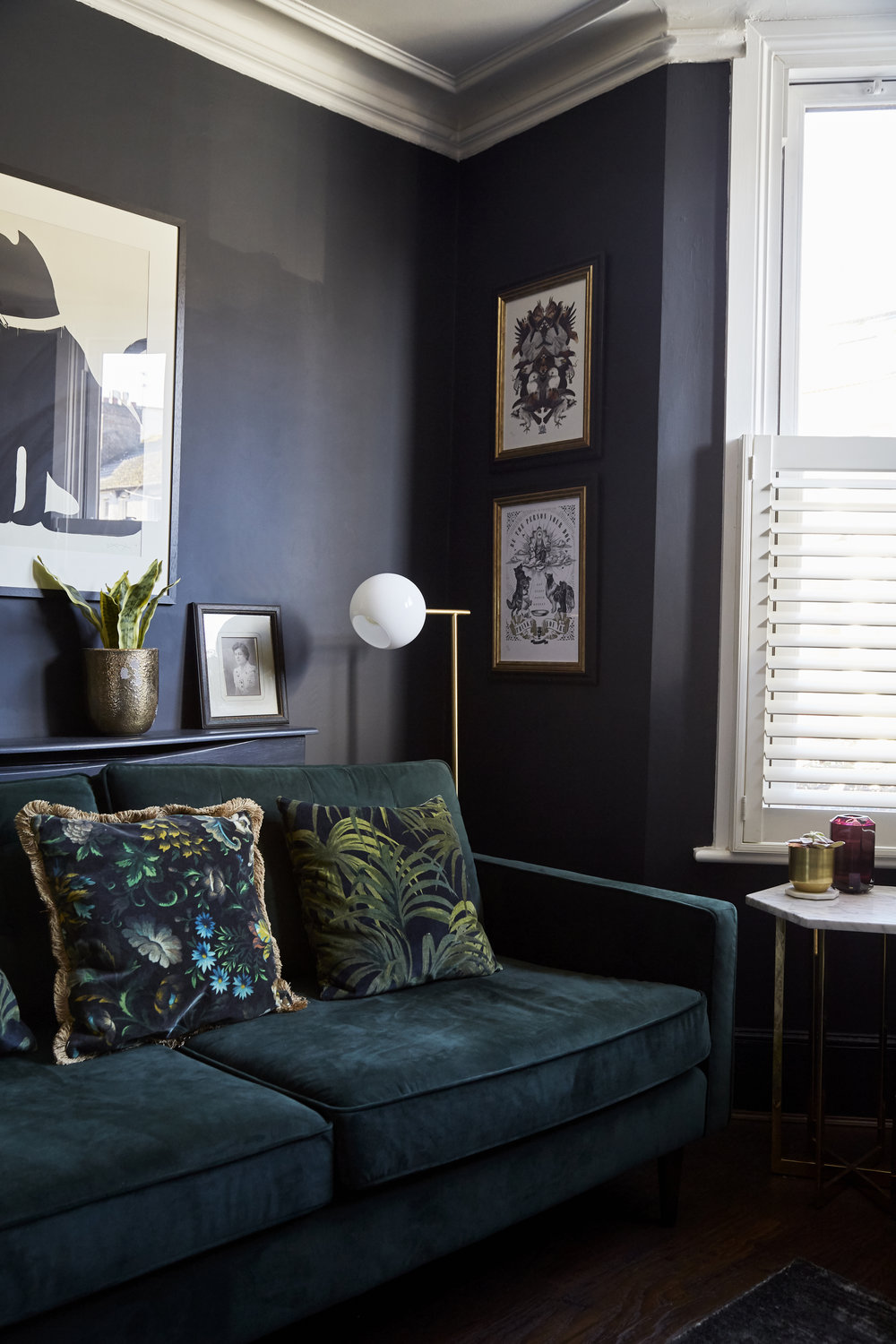 Drake Green velvet sofa   £999,   West Elm    ;    Staggered glass floor lamp    £199,    West Elm   ;    Distressed Arabesque Wool Rug - Steel   £449, From   West Elm  . Pair of prints on the wall are from   Divine Savages