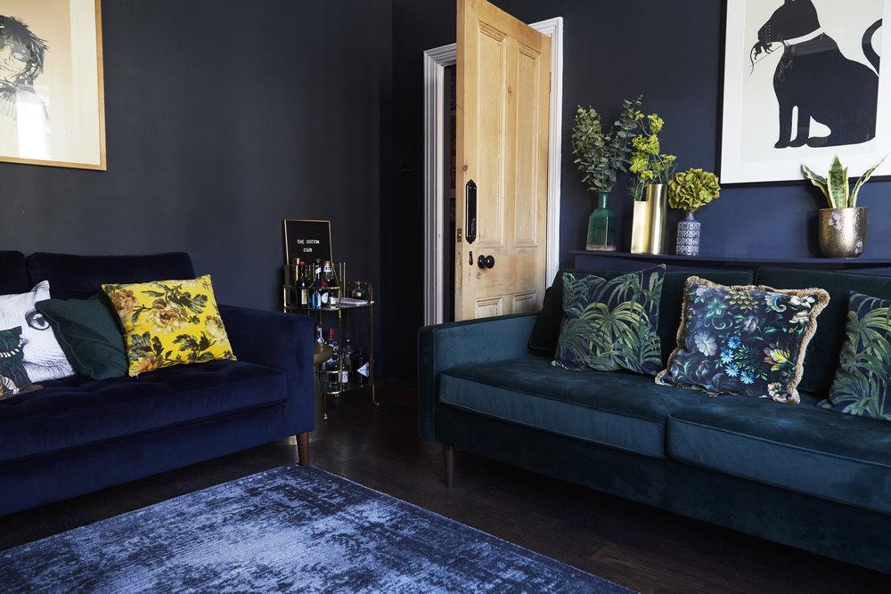 Drake Green velvet sofa   £999,   West Elm    ;    Staggered glass floor lamp    £199,    West Elm   ;    Distressed Arabesque Wool Rug - Steel   £449, From   West Elm  ;   Large Nikolitsi Vase    £14 from    Oka   .