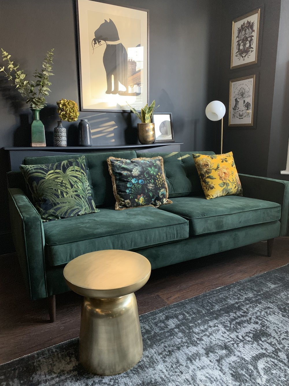 Drake Green velvet sofa   £999,   West Elm    ;    Staggered glass floor lamp    £199,    West Elm   ;    Martini side table in brass    £159,    West Elm   ;    Distressed Arabesque Wool Rug - Steel   £449, From   West Elm  .