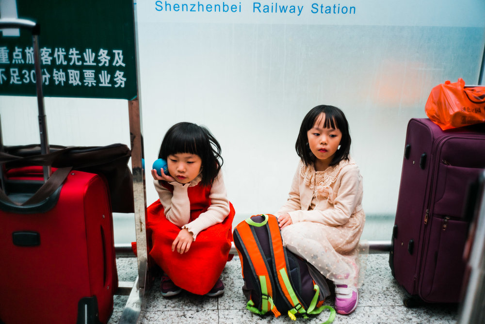 girls waiting at railway station.jpg