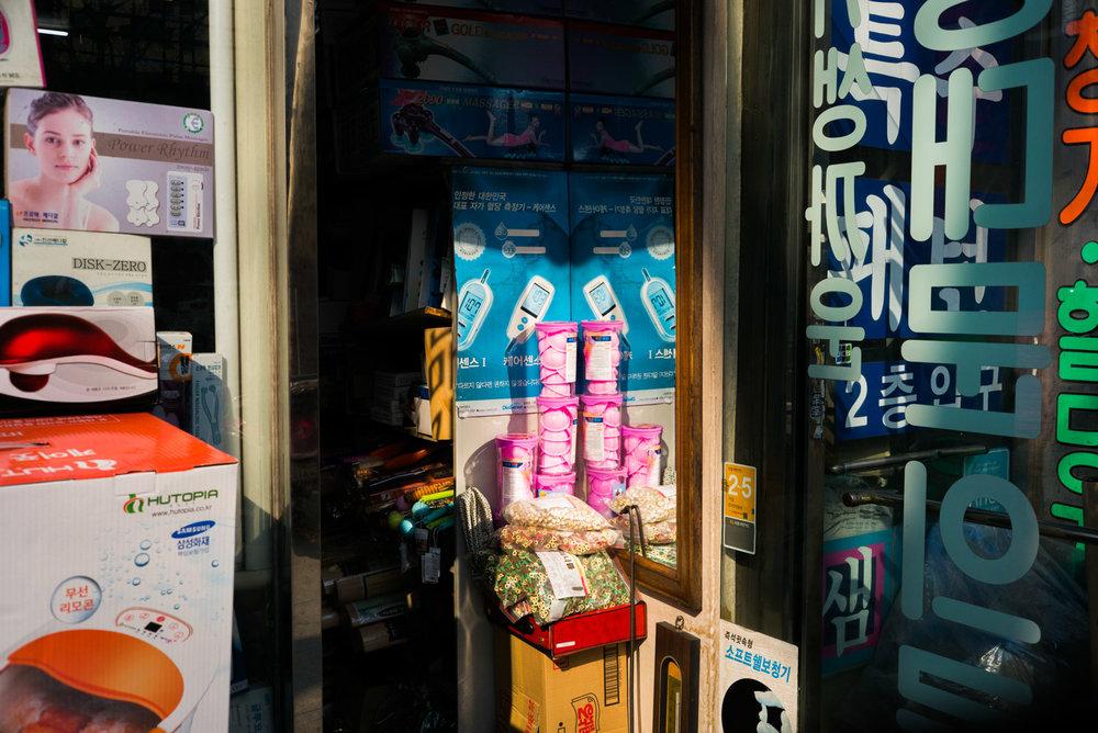 tennis balls in store front.jpg