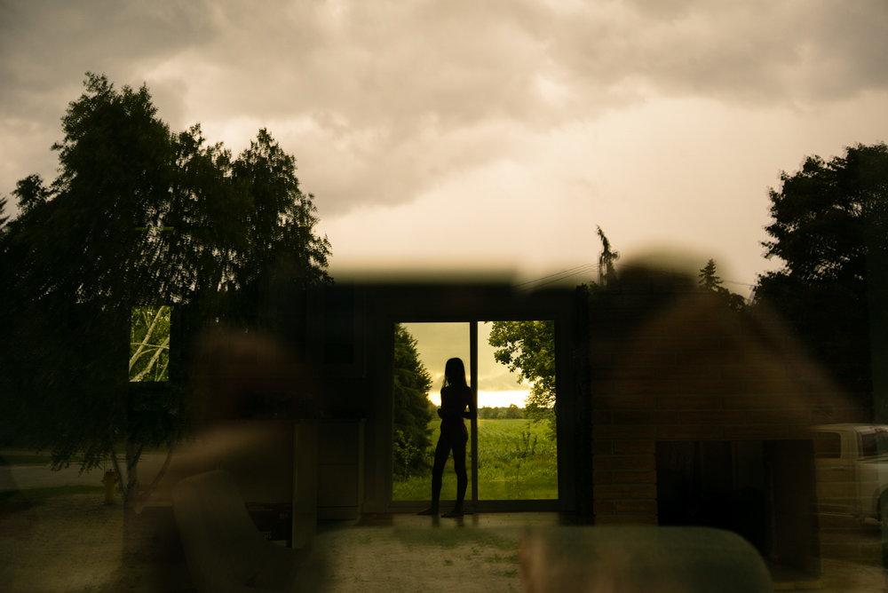 girl standing in the door.jpg