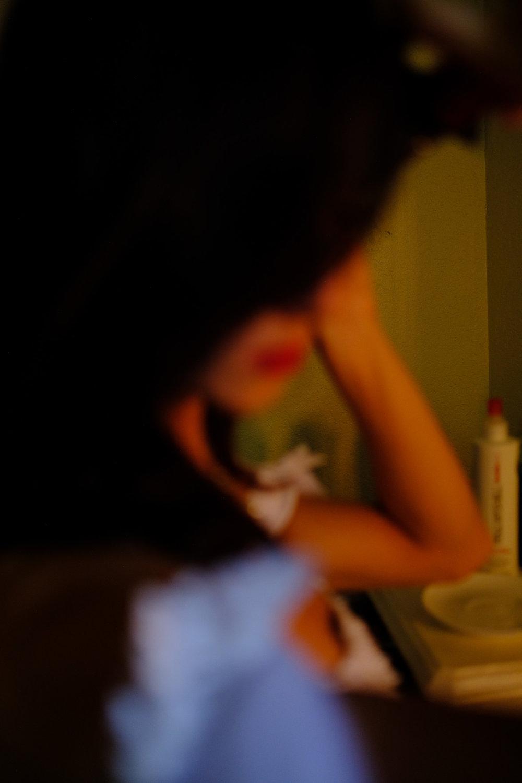 blurry photo of bride curling her hair.jpg