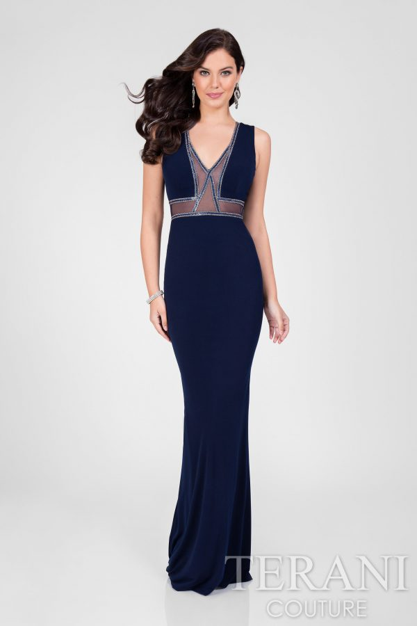Cadet blue v-neck jersey column designer dress for prom. This red carpet ready gown from our prom collection features streamlined beaded trim outlines on the sheer insets with an open back.    Comes in Navy    All prom dresses can be purchased in store or over the phone only.   Please call for sizes and holds   (303) 443-3976. More prom dresses in store.