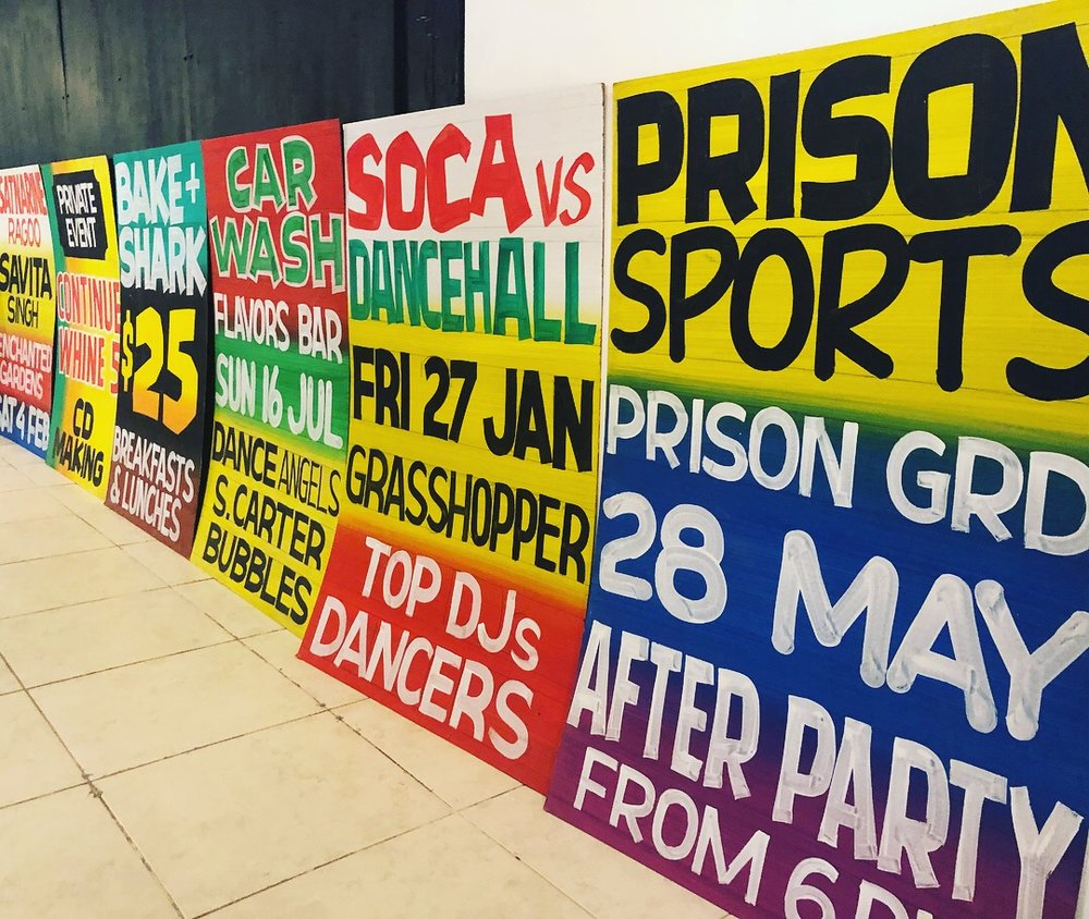 Some of the fete signs on display inside the venue.