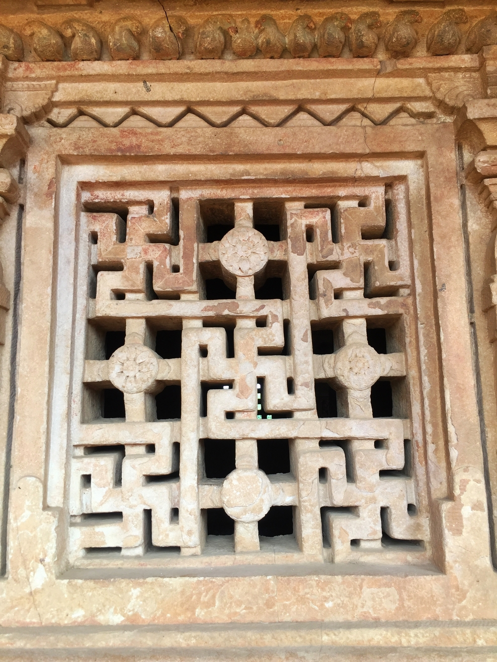 Swastika symbol (HInduism, Buddhism) of good luck and fortune in a temple window