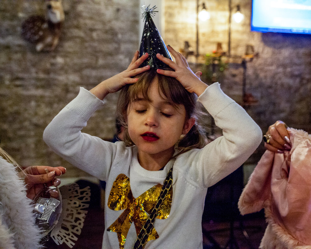 Stella Cortines regales herself with New Year's Eve getup at Mesquite Creek Outfitters while her family tries to coerce her into her coat two hours before midnight.