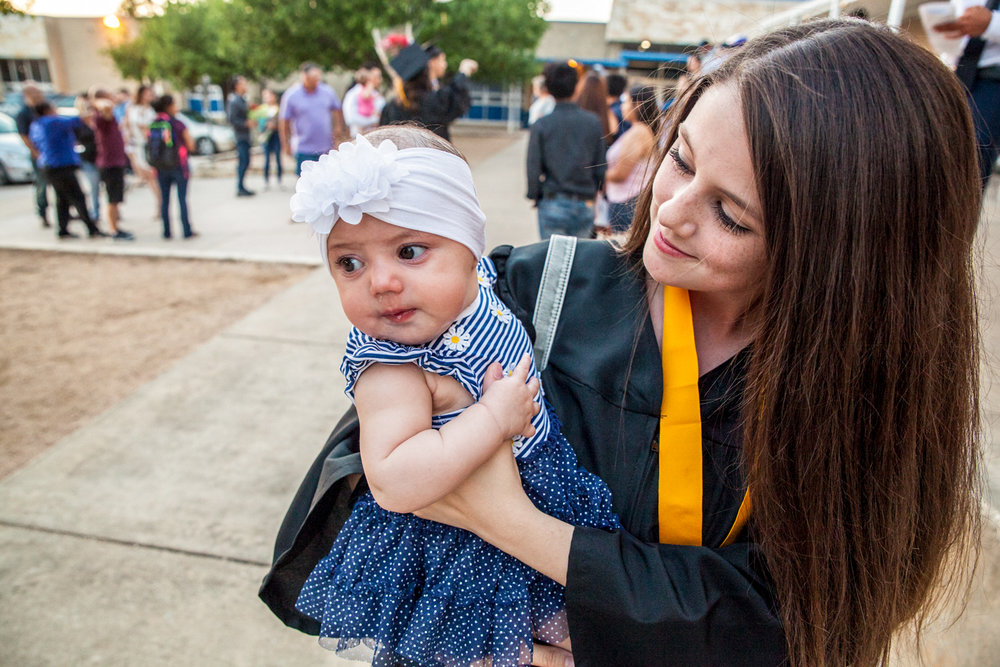 Britney Sanders holds her daughter, Annabelle Abundiz, after graduating from Richarte High School. Britney dropped out of high school after learning she was pregnant. Richarte, Georgetown's alternative school, gave her the flexibility and support she needed as a student mother, she said.