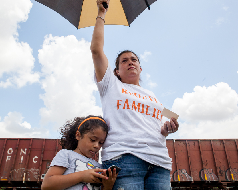 Alejandro Olvera, of Georgetown, and her daughter Jenny, 5, joined demonstrators at the T. Don Hutto Residential Center in Taylor on Sunday morning. Ms. Olvera spoke of the fear immigration issues and the local political climate have created amongst her community.