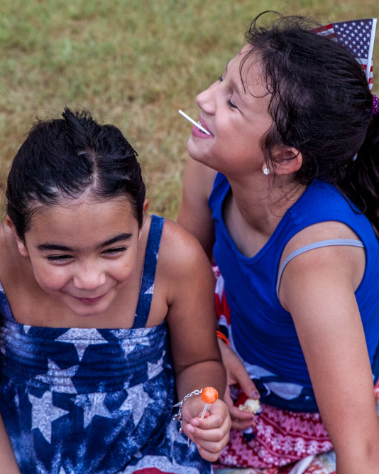 Bella Garcia, 8, and Molly Magiera, 10, goof off before the start of the 35th Annual Fourth of July Family Celebration in San Gabriel Park. The Magiera family comes to the firework show every year, mother Erica said.