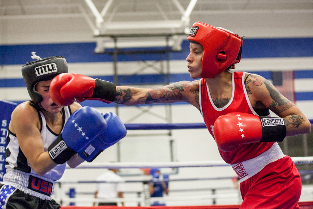 Darcy Vaquera lands a punch to Victoria Trabysh, both of San Antonio, during a fight at the annual Sterling Gloves Boxing Tournament this past weekend. The tournament brought thousands to the Georgetown High School gymnasium.