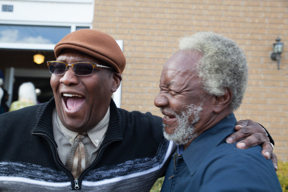 Reverend Lamar Claypool and Ernest Perry catch up outside of Macedonia Baptist Church in Georgetown after the annual MLK Day march.