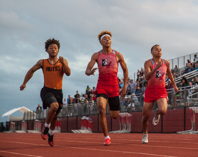 Devhaun Little, center, secures third place over Jake Brown, right, and a runner from Hutto High School in the 100-meter dash at the district track meet held at East View High School.