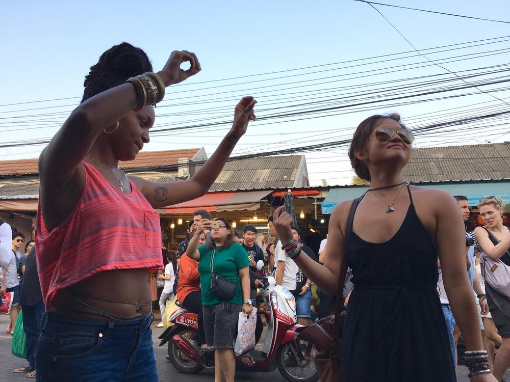 Dancing to music while enjoying lunch at the Chatuchak Weekend Market (aka JJ Market) in Bangkok, Thailand.