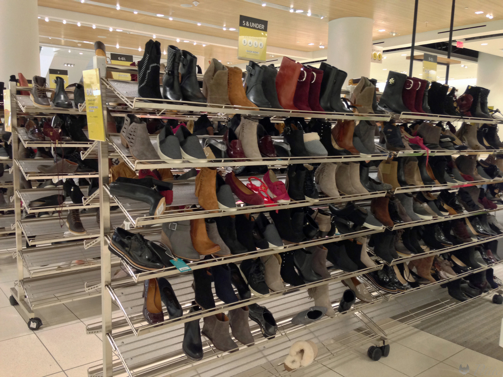 "The left half of this rack is dedicated to ""size 5 and under"".  Mostly ankle boots."