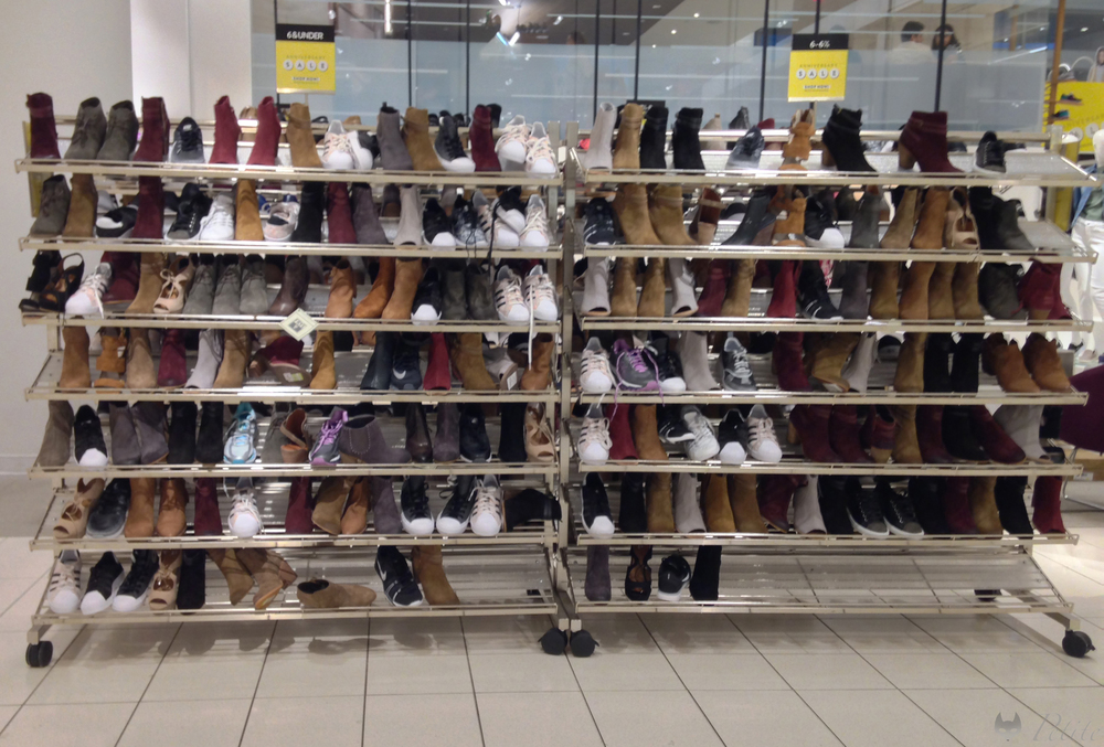 "In another shoe sale section, the left side of this rack is ""size 6 and under"" and contains several 5's and 4.5's."