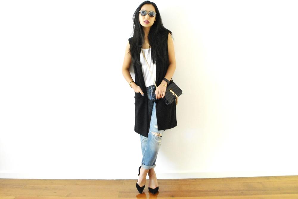 Jeans: Levis, Tank: Acne Studios, Pumps: H&M, Bag: YSL, Glasses: Dior