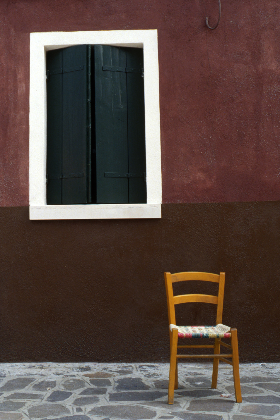 Yellow Chair, Burano Italy, 1978 , Cibachrome Print, 24 x 16cm, Edition of 10.                            Exhibition:  Burano Colour Works , Australian Centre for Photography, Sydney; Solander Gallery, Canberra; Wagga Wagga City Art Gallery, Wagga Wagga, 1979.