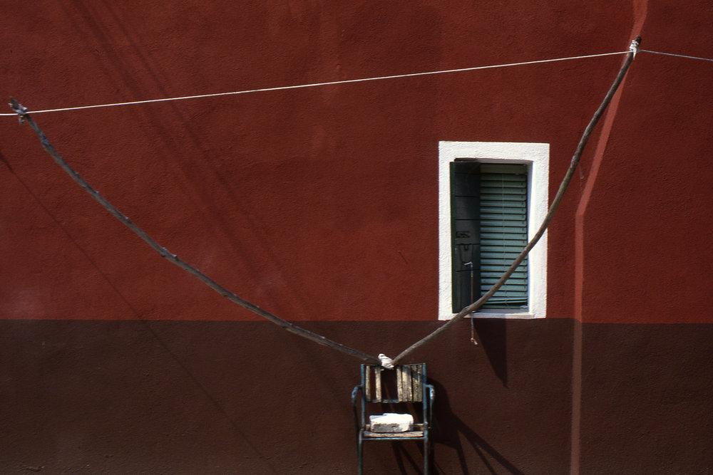 Red Wall with Clothesline, Burano Italy, 1978 , Cibachrome Print, 16 x 24cm, Edition of 10.                            Exhibition:  Burano Colour Works , Australian Centre for Photography, Sydney; Solander Gallery, Canberra; Wagga Wagga City Art Gallery, Wagga Wagga, 1979.