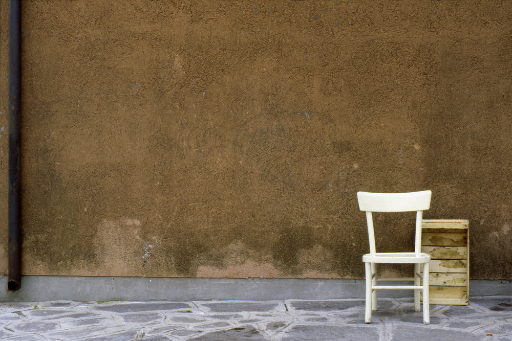 Chair and Box, Burano Italy, 1978 , Cibachrome Print, 16 x 24cm, Edition of 10.                            Exhibition:  Burano Colour Works , Australian Centre for Photography, Sydney; Solander Gallery, Canberra; Wagga Wagga City Art Gallery, Wagga Wagga, 1979.