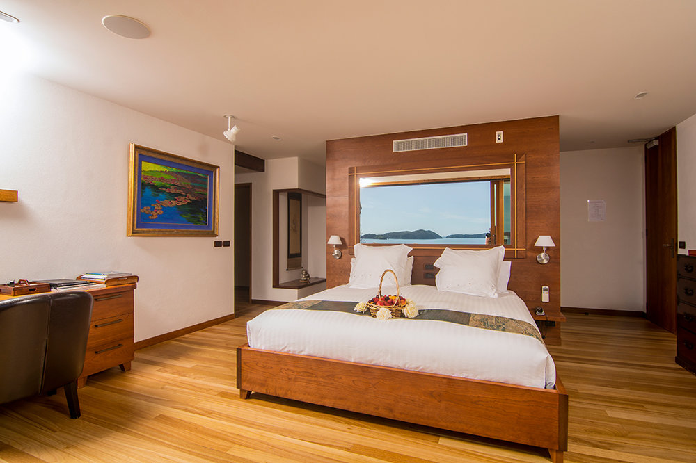Super king-size bed and panoramic ocean views