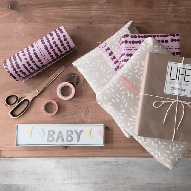 babyshower gifts wrapped garland.jpg
