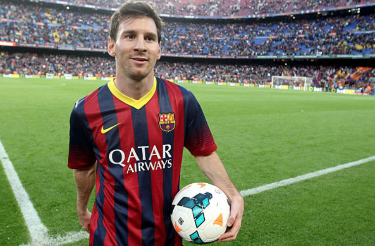 Lionel Messi with the match ball after scoring his hat-trick vs Osasuna in March 2014 which broke Paulino Alcantara's Barcelona goalscoring record. (Miguel Ruiz/FC Barcelona)
