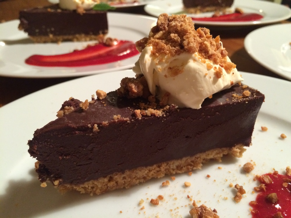 Chocolate truffle torte with peanut brittle