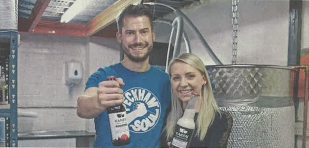 Tom Wilson (left) and Lucy Holmes holding their own junmai and nigori sake, London, July (Kyodo)
