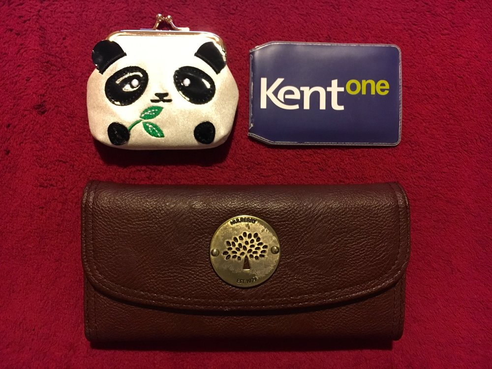 Keys go in the panda coin purse and the regular purse is a knock-off! God bless, Stanley Market.