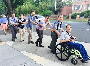 Members of L'Arche Chicago form a conga line.