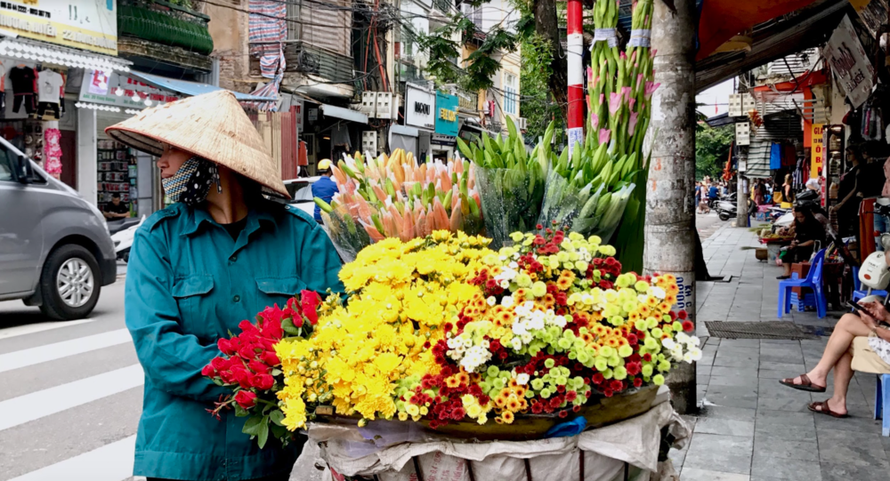 A simple picture of the beauty found in Vietnam. I took this picture in Old Quarters - a rather touristy part of the city, but a place full of culture, fun, and street vendors like this. Aren't the flowers pretty? They smelled just as sweet!