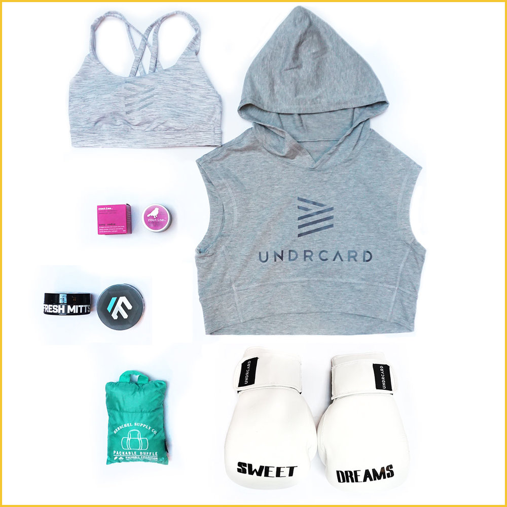THE ANGEL.  Upbeat and always ready with a smile.  Lululemon x UNDRCARD Energy Bra , UNDRCARD Crop Hoodie,  Routine Cream ,  Fresh Mitts glove deodorizer ,  Herschel packable duffle ,  UNDRCARD Sweet Dreams gloves .