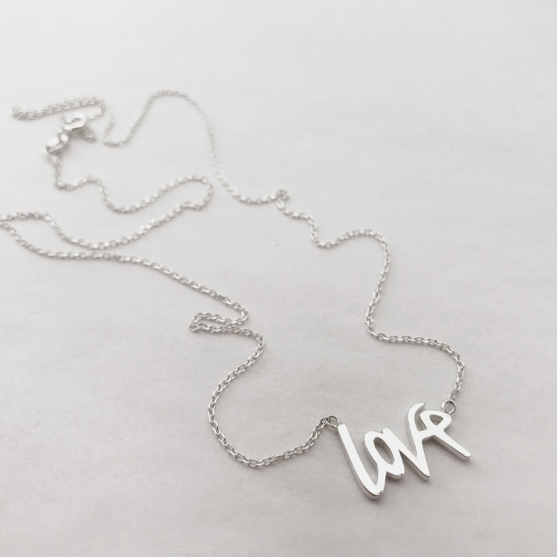 Love necklace - The LITZI script love necklace, special edition 14k rose gold for breast cancer awareness month. Available also in sterling silver.For the month of October, 40% of the proceeds from the sale of each necklace goes to the Quebec Breast Cancer Foundation and their partnership with the Montreal Jewish General Hospital.The money raised goes towards research and initiatives at the Jewish General Hospital to benefit breast cancer patients in Quebec and beyond.Love is 16mm across x 11mm and in solid 14k rose gold or sterling silverChain is available in 16
