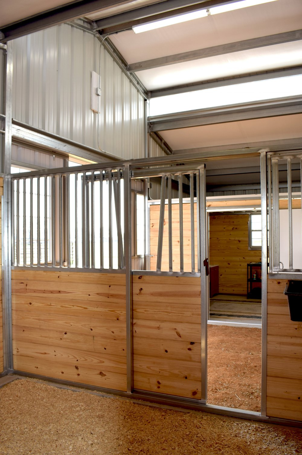 Sliding Stall Door with Yoke Grill, Raised Center Aisle with Skylights