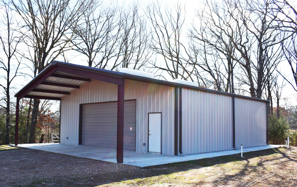 This building includes a 12' roof extension and a 12' x 10' Sandstone Colored Overhead door.