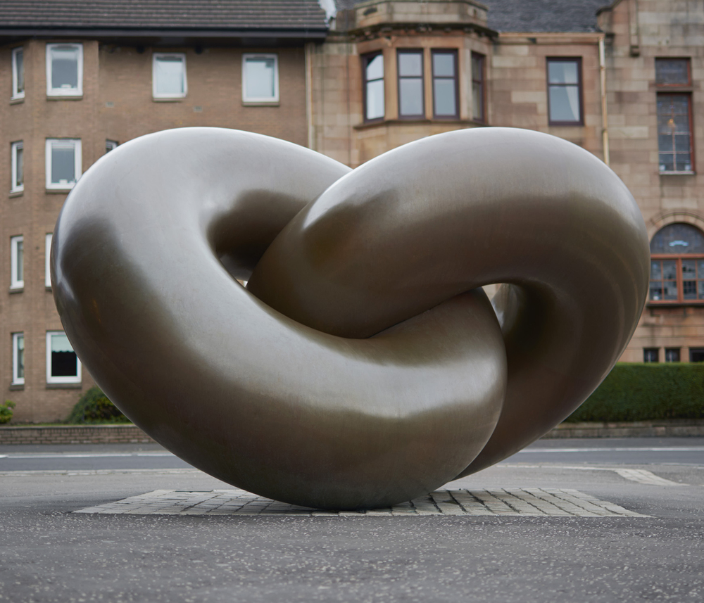 EMBRACE 2003 Bronze Size: 3 x 1.5 x 2m /  9.8 x 4.9 x 6.5ft Glasgow, Scotland Overview: Created from two intertwined bronze tori, each passing through the respective centres of the other, providing balance and support, Embrace symbolise the interaction and interdependence of human relationships and the dualities of life.