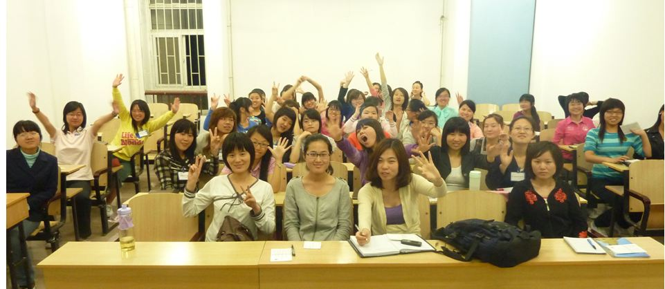 About half the class from the World Academy of Women