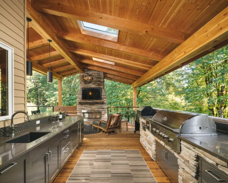 An outdoor kitchen is an ideal overflow space for people who love entertaining. Weather won't kill the party! Image vis Neil Kelly