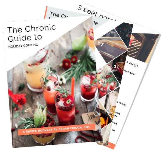 an image of A couple of pages from the chronic guide to holiday cooking booklet. The front page has the title on it in a white triangle at the top, an image of festive drinks decorated with cranberries, flowers, a red bird and evergreen branches. Behind the cover another two pages are spread out in a fan shape. They include the table of contents and one of the recipes.
