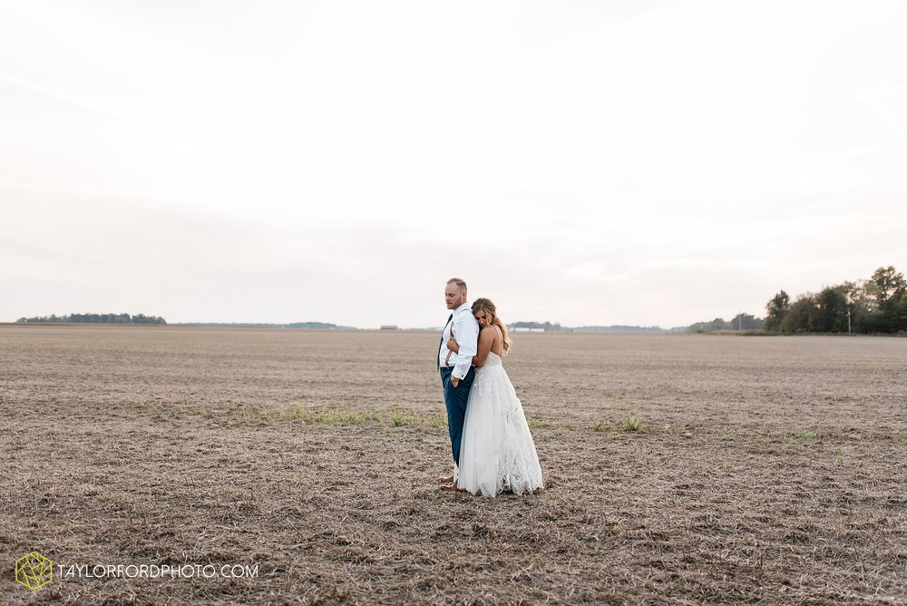 mckenzie-nofer-jordan-gibson-van-wert-ohio-wedding-saint-marys-of-the-assumption-backyard-pull-barn-reception-country-horse-photographer-taylor-ford-photography_1162.jpg