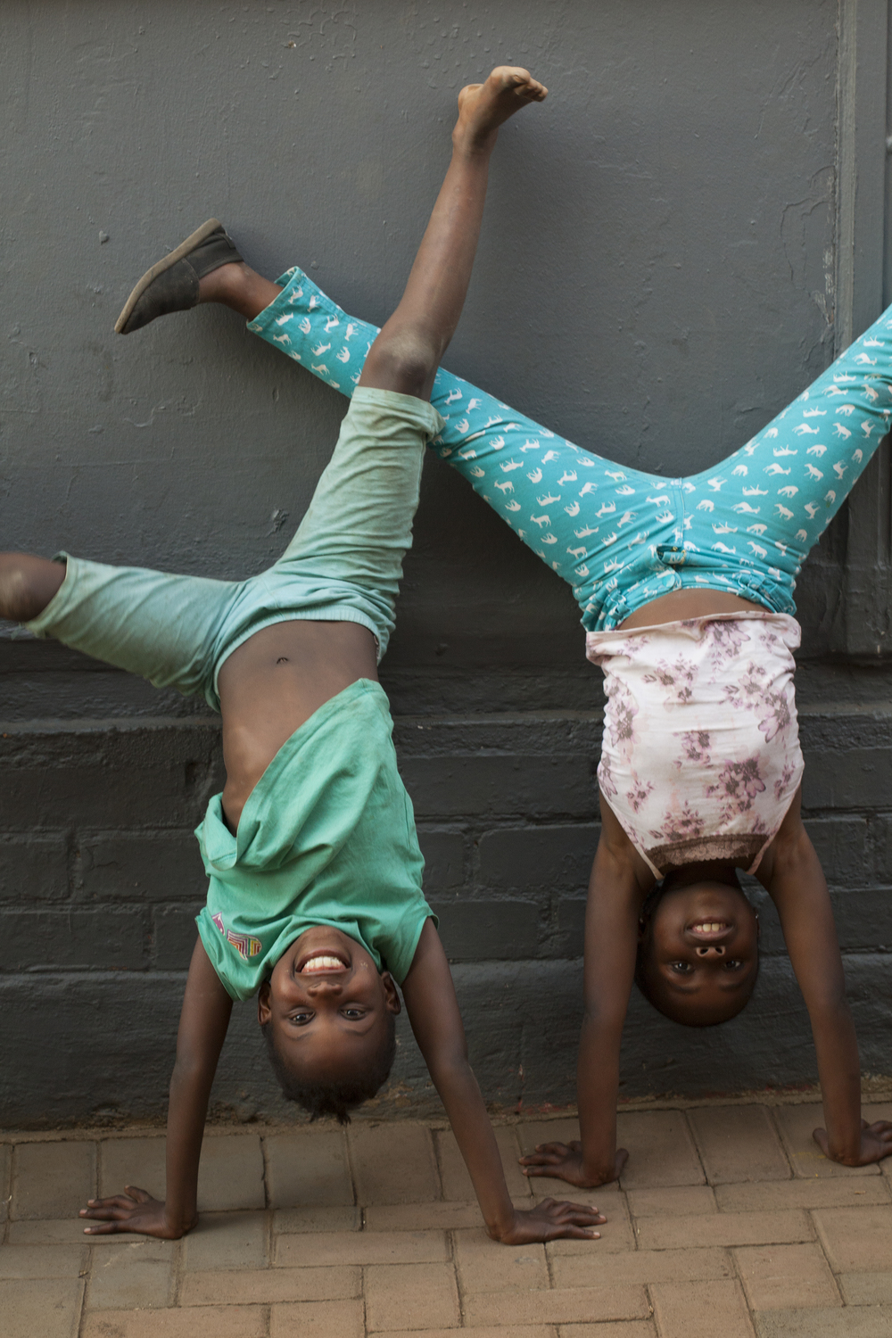 Girls at the Kliptown Youth Program show off their handstands for me when I visited Soweto, South Africa, to teach a photography workshop in 2014 with the Kliptown Photography Project. To learn more about that project, go to:  http://www.kliptownphotography.com