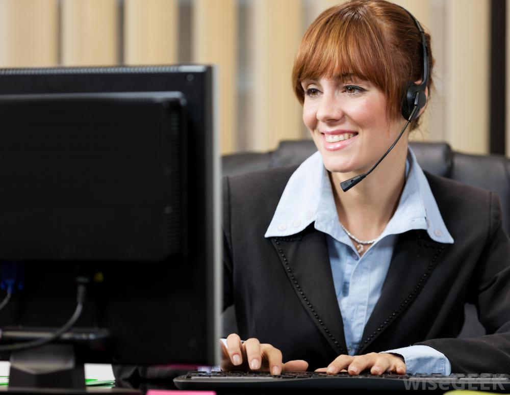 red-haired-woman-at-computer-with-phone-ear-piece.jpg
