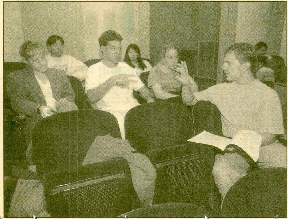 Wolff (right) discusses his playing with Matt Goodrich and other students in a performance class at the University of Washington