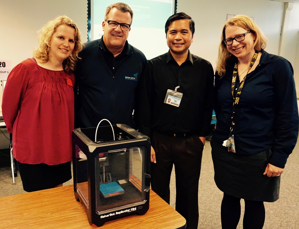 Frank and Camille Paton with Computer Lab Specialist Dennis Carreon and Director of Technology Jamie Lewsadder
