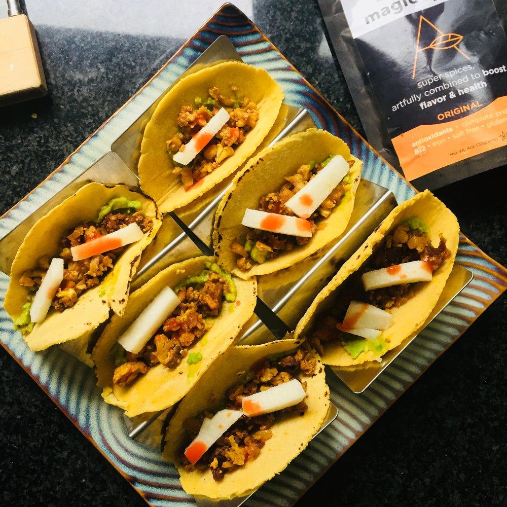 Magic cauliflower,mushrooms and nut tacos, topped with jicama, guacamole and salsa