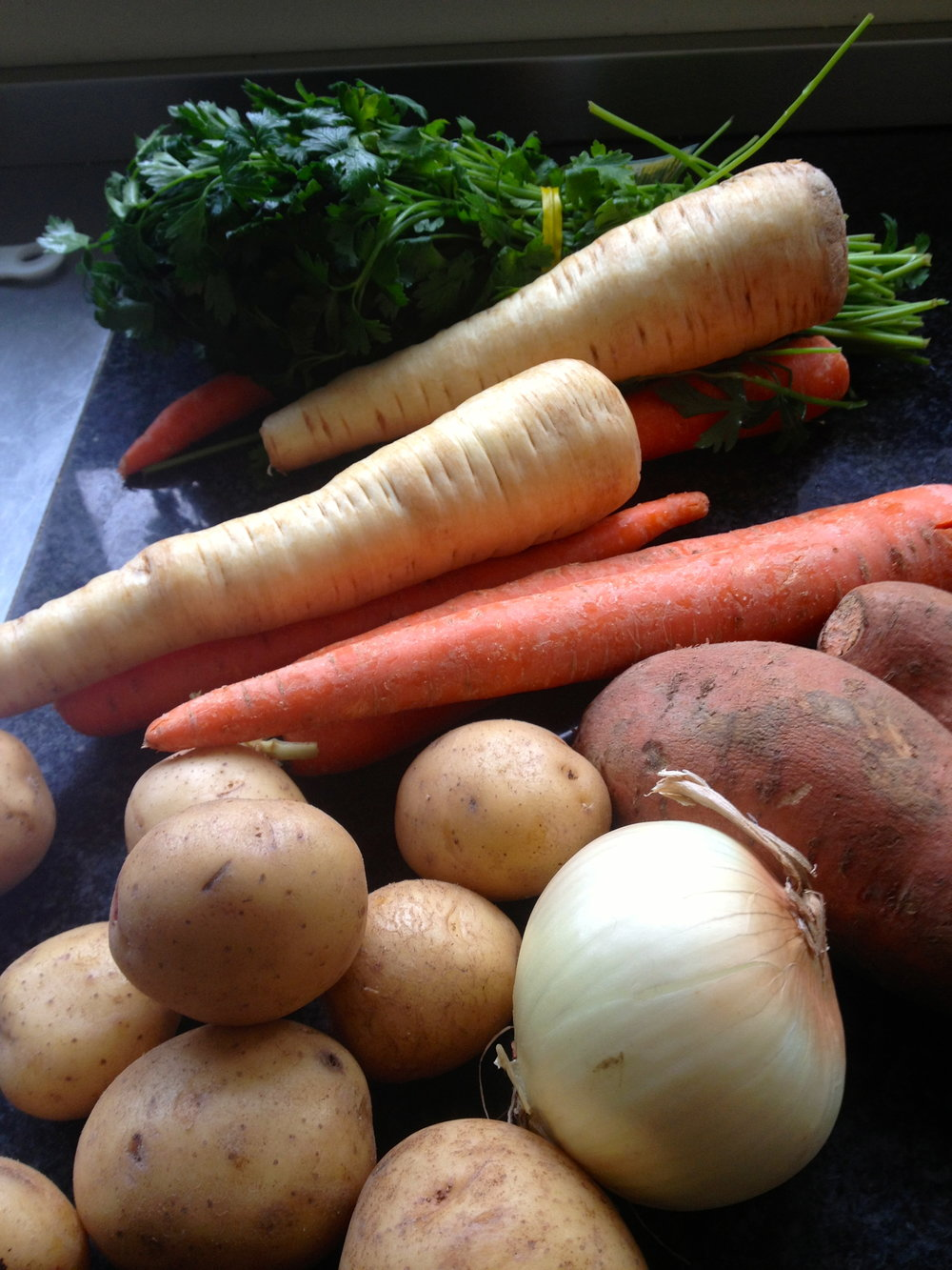 Onion, zucchini, carrots, potato & sweet potato are the base of the soup, but all veggies welcome