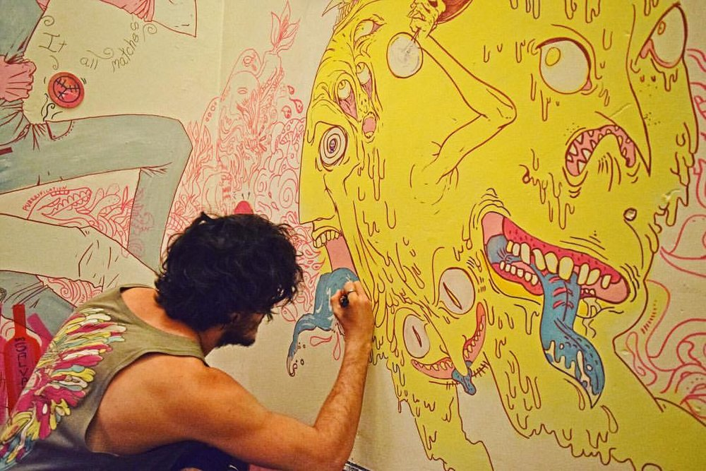 Michael Katchan working on a mural in 2016. Photo: Facebook