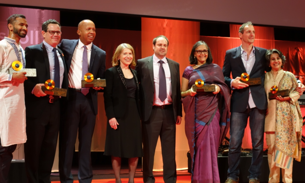 Skoll Awardees Vivek Maru, Chuck Slaughter, Bryan Stevenson, Skoll Foundation CEO Sally Osberg, Jeff Skoll, and Skoll Awardees Mallika Dutt, Oren Yakobovich and Sonali Khan.