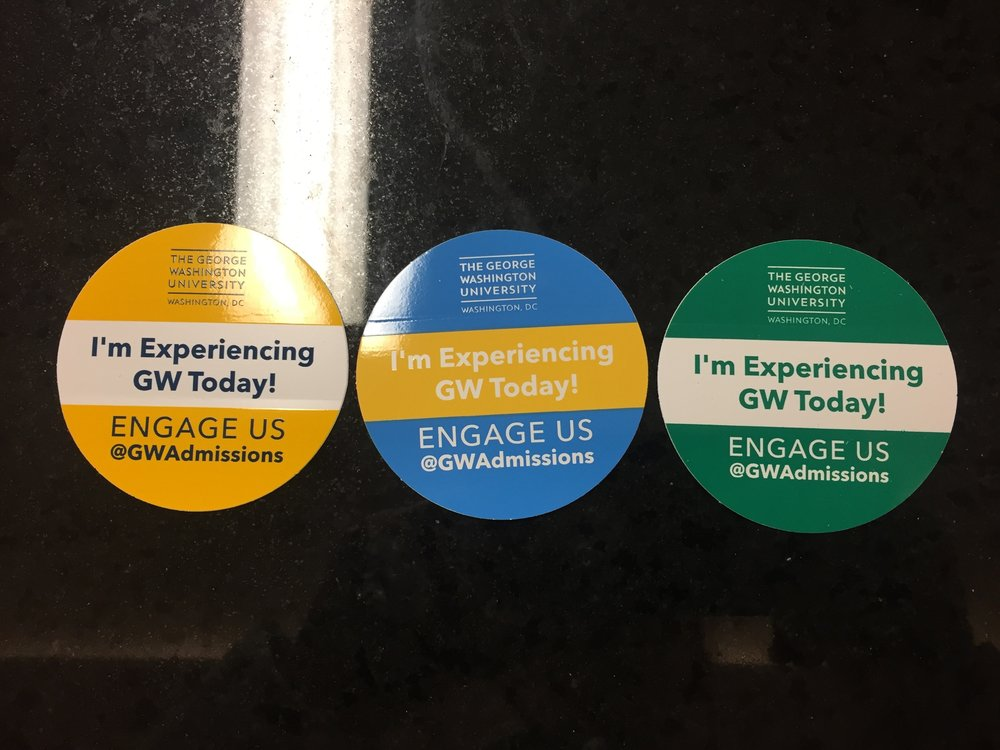 George Washington University uses different colored stickers (dependent on where they are at in the admission process) to identify visitors while on tour.